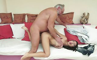 A brunette that enjoys attention is getting fucked by an old stud