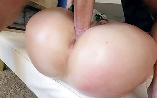 A huge ass bimbo is getting glazed with body oil and she is fucked