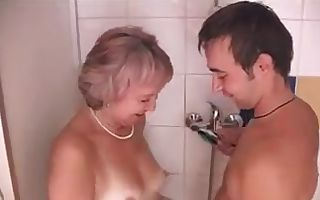 Old   younger - granny and young in shower