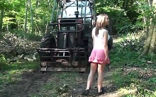 junior blond does blowjob in the forest